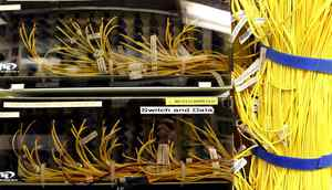 Wires connecting servers installed by telecommunications and IT companies in the building located on 151Front Street. Owned by Allied Properties REIT, the place is dedicated to rent space to companies in need of high volumes data storage and traffic. Toronto September 08, 2010. (Fernando Morales/The Globe and Mail)