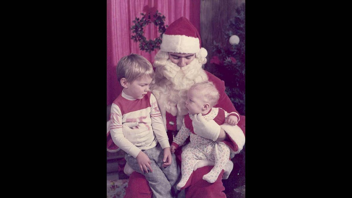 """Wendy Simmons photo: Santa with the kids - Taken about thirty five years ago, this photo of my two sons still makes me smile. Mark looks at his big brother as if to ask """"Is this guy OK?"""", while Paul doesn't seem too sure either."""