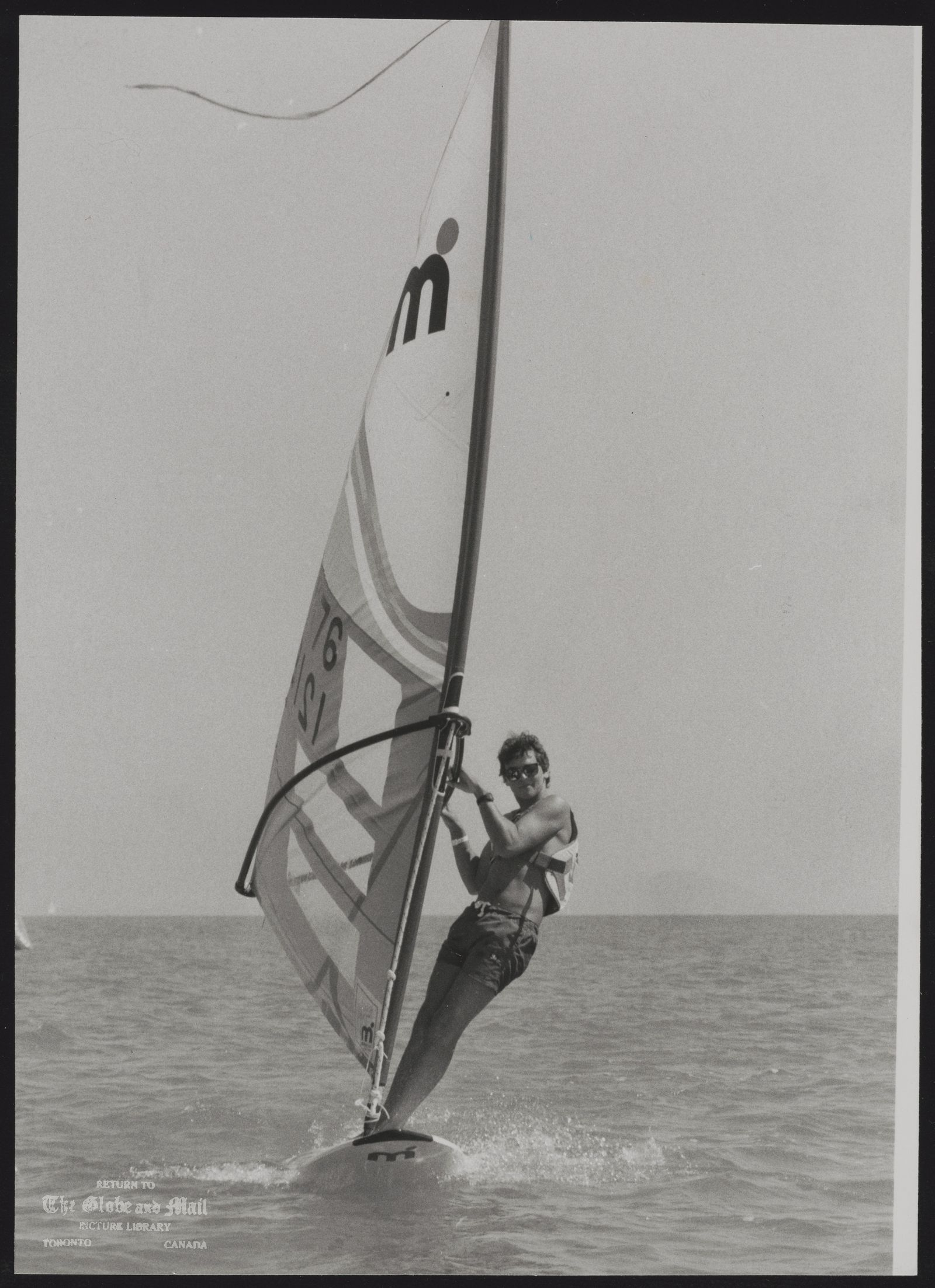 WINDSURFING Paul Mounder of Toronto captures 18-and under youth board sailing championship Saturday at Toronto s Balmy Beach.