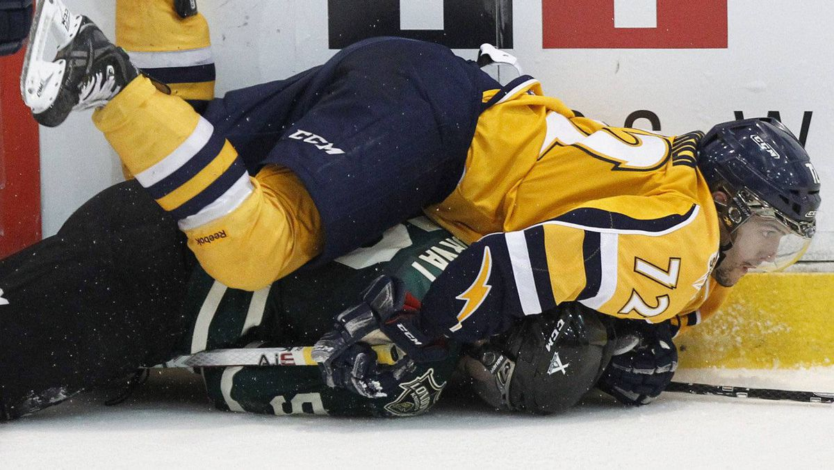 Shawinigan Cataractes Loik Poudrier (72) falls over London Knights Bo Horvat during the third period of their Memorial Cup final ice hockey game in Shawinigan, Quebec May 27, 2012. REUTERS/Mathieu Belanger
