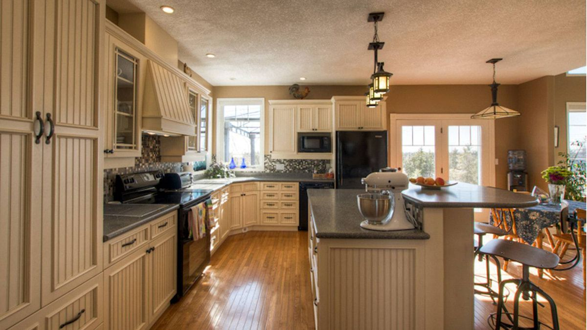 The large open kitchen features an island with Corrinne countertops and island.