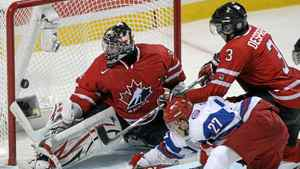 Team Russia forward Artemi Panarin (27) scores the game winning goal on Team Canada goaltender Mark Visentin (30) as defenceman Simon Despres (3) defends during third period Gold medal game at the IIHF World Junior Hockey Championships in Buffalo, N.Y. on Wednesday January 5, 2011.
