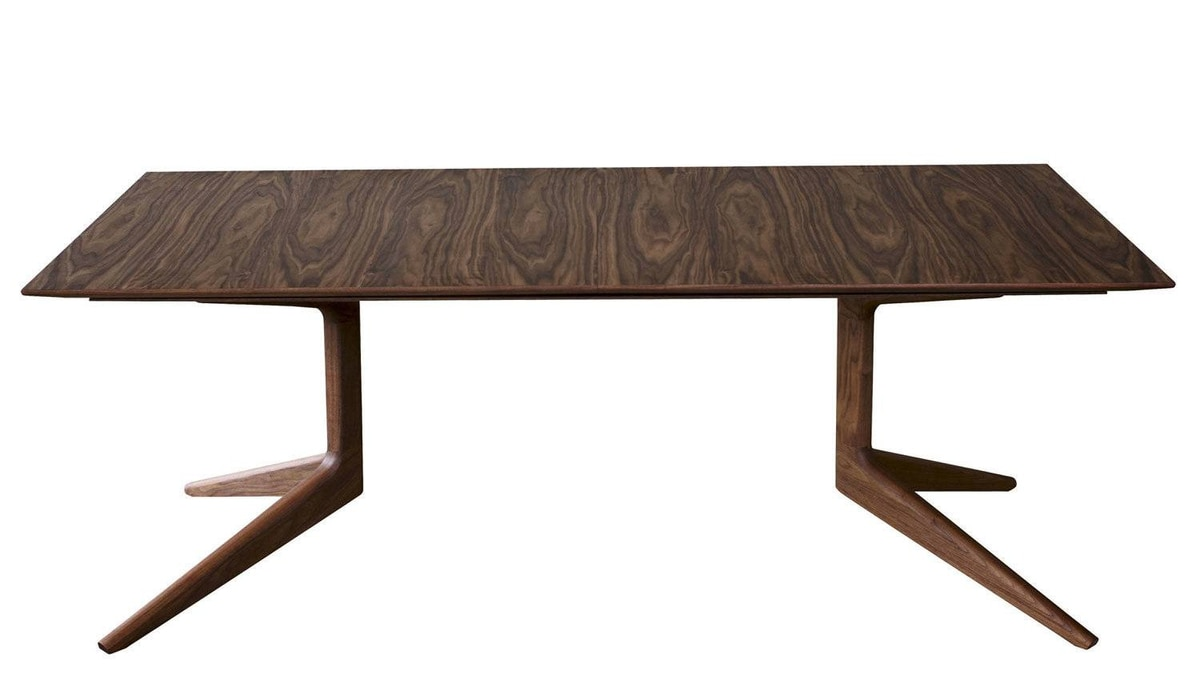 Matthew Hilton's sculptural extending table for De La Espada is available in American black walnut and American white oak; pair it with coloured, upholstered or contrasting-wood seating for an eye-catching ensemble. Light Extending Table, from $9,400 at select retailers in Vancouver, Calgary and Toronto.