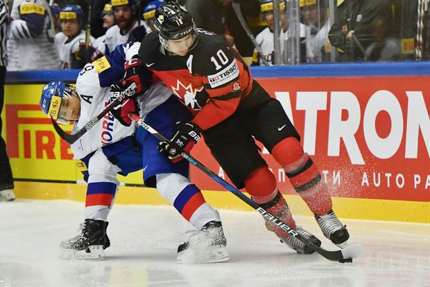 3b46e5847af Canada s Brayden Schenn challenges for the puck with South Korea s Cho  Minho during a Group B match at the 2018 IIHF Ice Hockey World Championship  at the ...