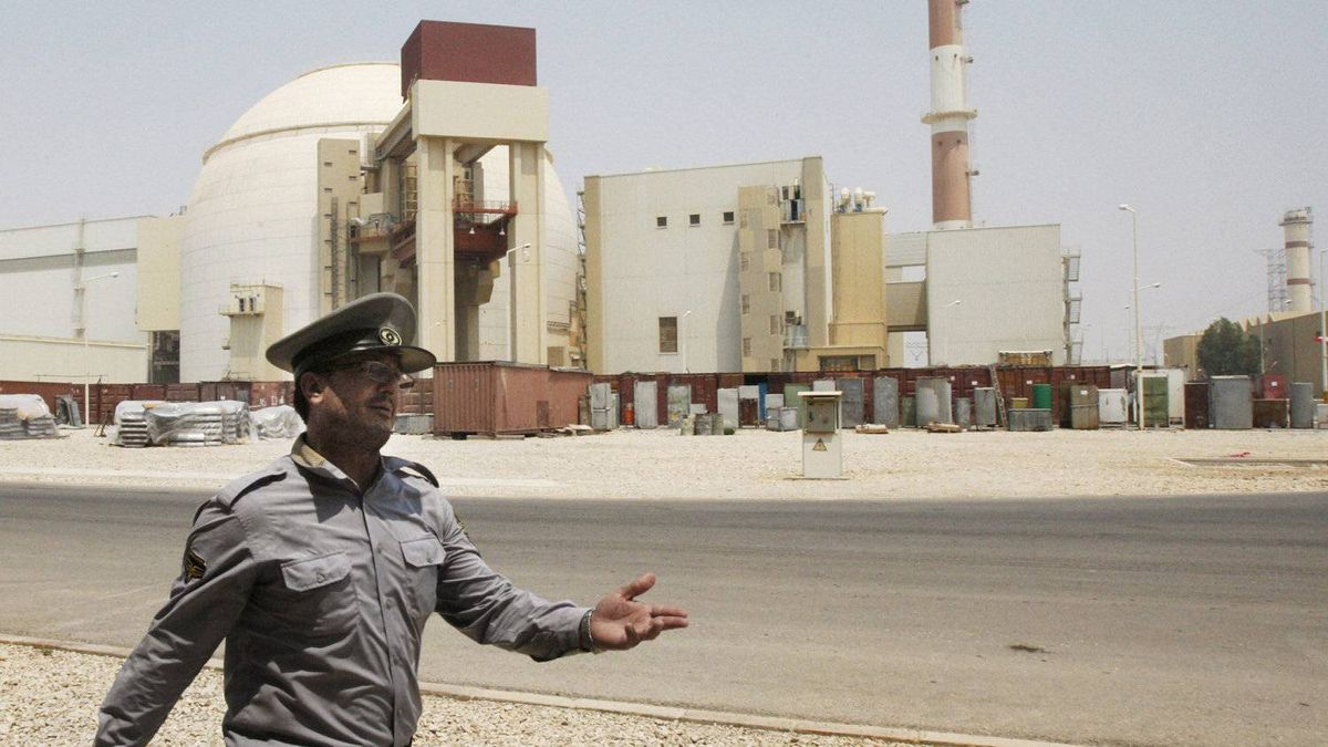 In this Saturday, Aug. 21, 2010, file photo, an Iranian security directs media at the Bushehr nuclear power plant, with the reactor building seen in the background, just outside the southern city of Bushehr, Iran. The U.S. has plans in place to attack Iran if necessary to prevent it from developing nuclear weapons, Washington's envoy to Israel said, days ahead of a crucial round of nuclear talks with Tehran.