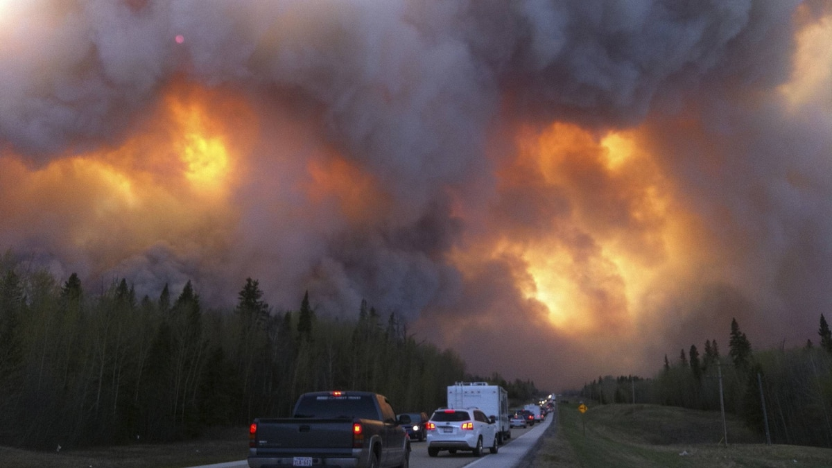 Fires rage this past May in Slave Lake, Alta., where 7,000 people had to flee as the inferno raced into town. The forest-fire season has been starting earlier and lasting longer in recent years.