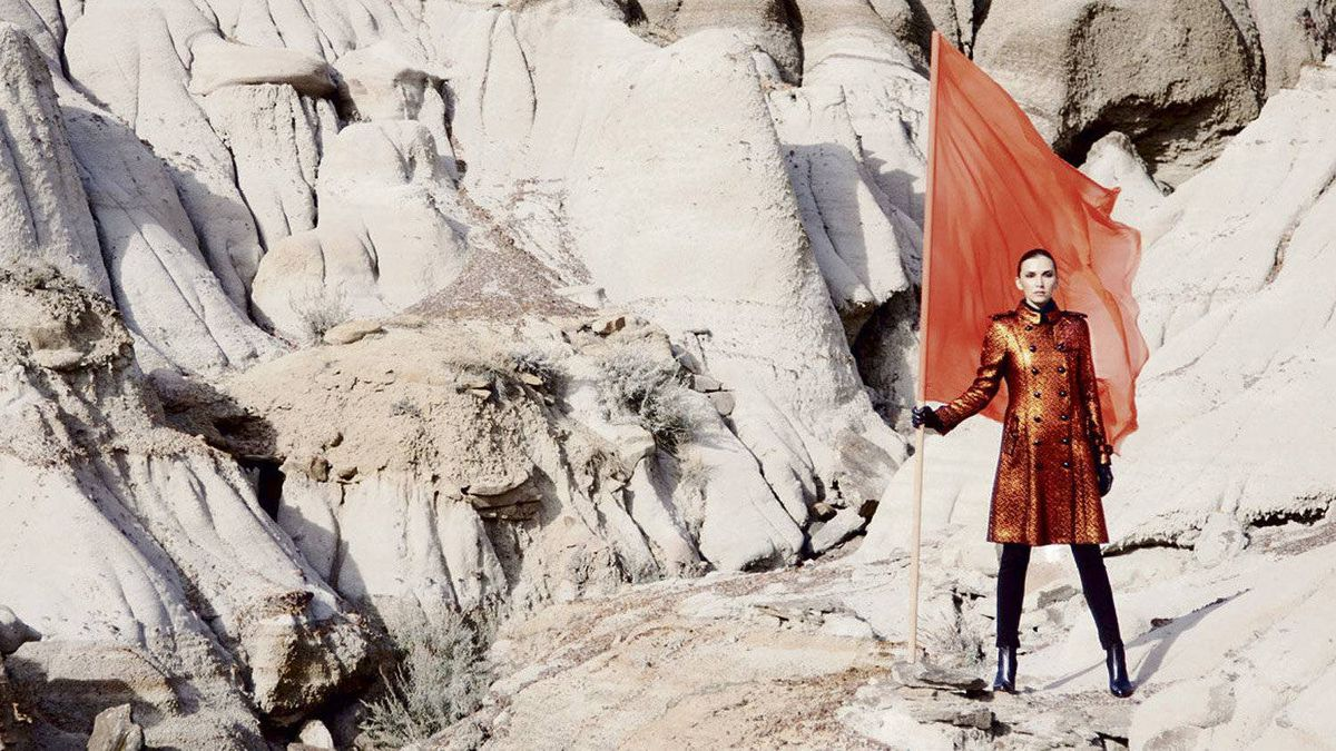 A model wears a Hermes military jacket while on scene in the Canadian Badlands.