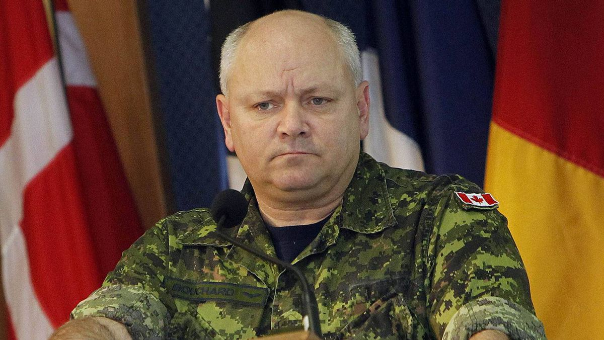 Canadian Lieutenant General Charles Bouchard, commander of the NATO military operations in Libya, listens to a reporter's question during a media briefing at the NATO's Southern Europe headquarters in Naples March 28, 2011.