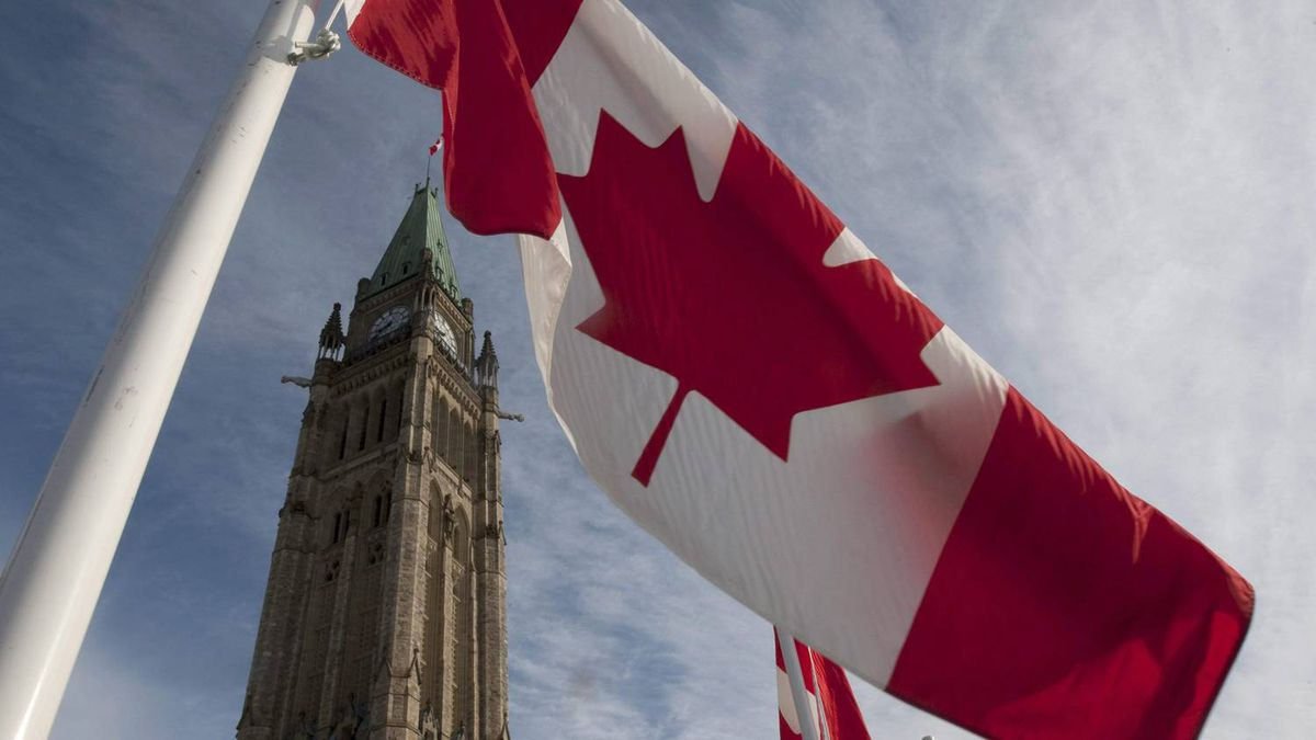 Canadian flag on Parliament Hill in Ottawa