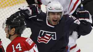Patrick Dwyer of the U.S. celebrates after scoring next to Canada's Jordan Eberle during their 2012 IIHF ice hockey World Championship game in Helsinki May 5, 2012.