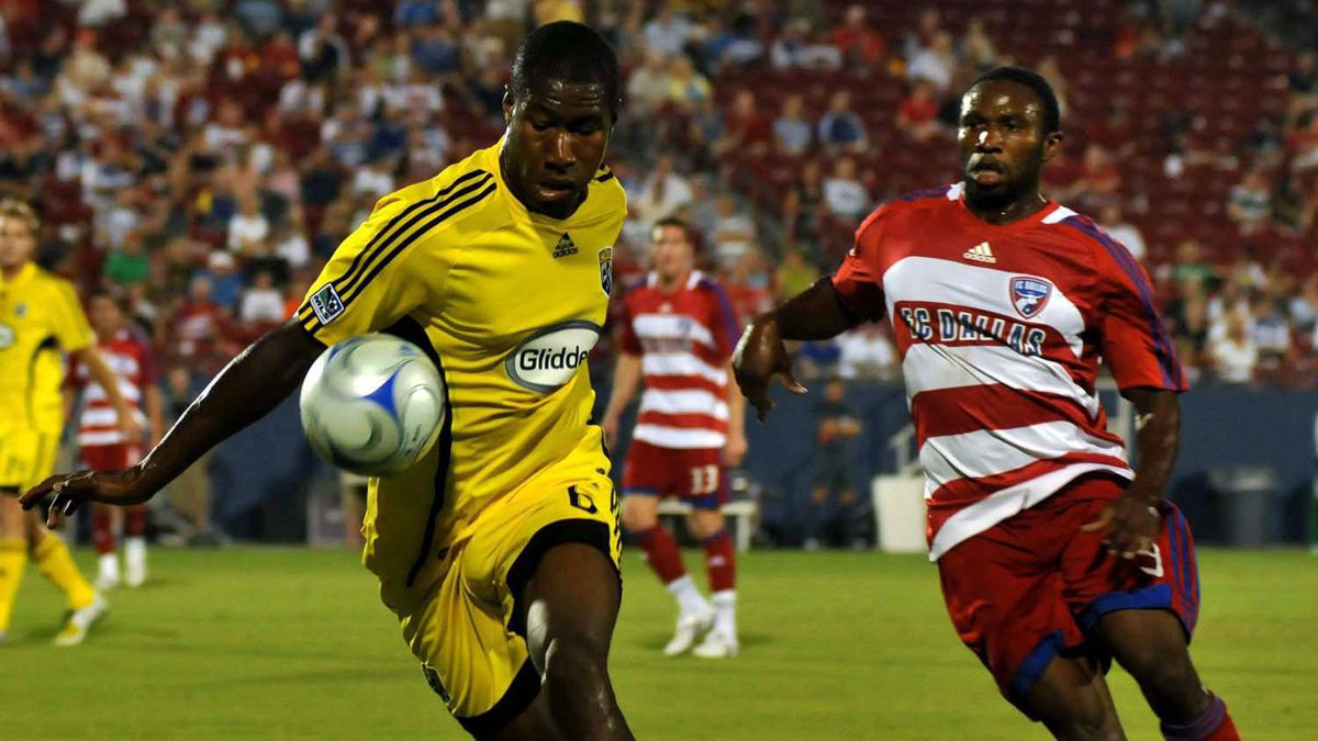 Columbus Crew's Andy Iro, left, controls the ball as FC Dallas' Jeff Cunningham, right moves in during a MLS soccer game in Frisco, Texas on Saturday, Aug. 30, 2008.