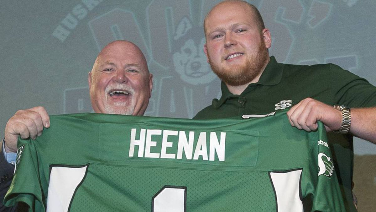 Jim Hopson, president and CEO of the Saskatchewan Roughriders (left) announce they will select U of S University of Saskatchewan Huksies offensive line Ben Heenan (right) first in the CFL draft later in the day during the 12th annual Dog's Breakfast at Prairie Land Park in Saskatoon, Sask., Thursday
