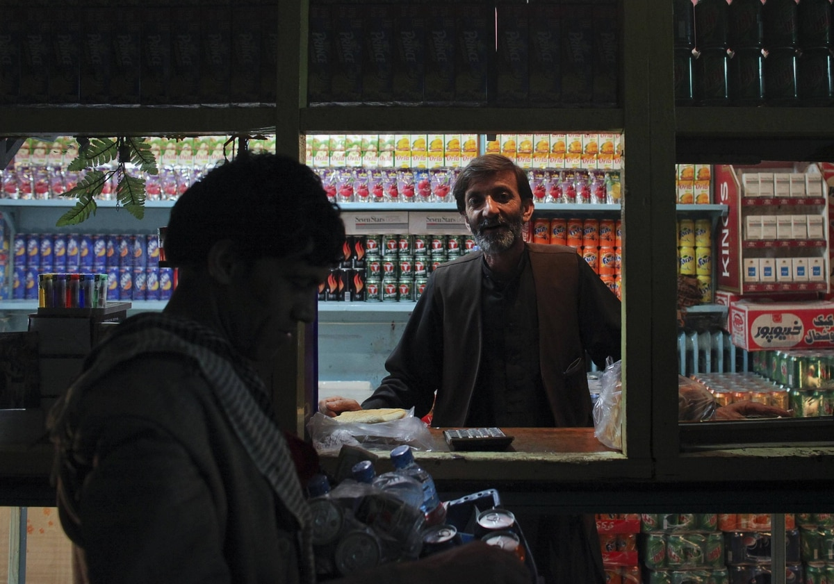 Employees of Cinema Pamir sell refreshments during the movie interval in Kabul. Kabul's cinemas show Pakistani films in Pashto, American action films and Bollywood to rowdy, largely unemployed crowds in pursuit of any distraction from their drab surroundings.