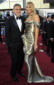George Clooney and his golden statuesque pose on the Oscars red carpet on Sunday.
