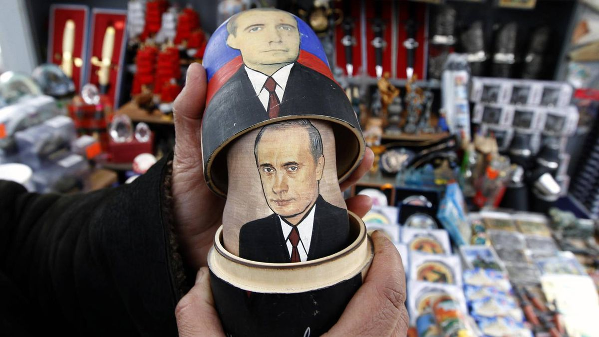A seller demonstrates a traditional Matryoshka doll, or Russian nesting dolls, bearing the faces of presidential candidate and current Prime Minister Vladimir Putin and President Dmitry Medvedev in St. Petersburg March 3, 2012. Russians will go to the polls for their presidential election on Sunday.