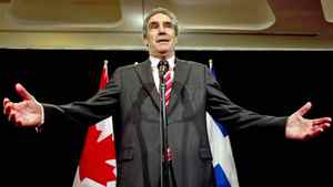 Liberal Leader Michael Ignatieff speaks to reporters while campaigning in Montreal on March 27, 2011.