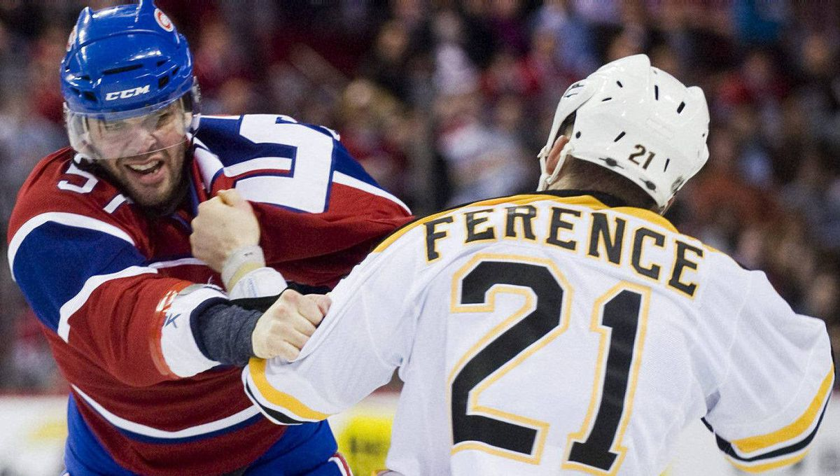 Montreal Canadiens' Benoit Pouliot, left, fights with Boston Bruins' Andrew Ference during first period Game 3 NHL Stanley Cup playoff hockey action in Montreal, Monday, April 18, 2011. The Bruins won 4-2. THE CANADIAN PRESS/Graham Hughes