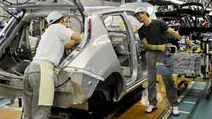 Employees assemble the Nissan Leaf electric vehicle at the Oppama plant in Yokosuka city, near Tokyo, on July 2, 2011. Nissan started factory operation on Saturday and Sunday this month as Japan Automobile manufacturers Association agreed to close their factories on Thursday and Friday for power saving due to the expected power shortage in the wake of the March 11 earthquake and nuclear disaster.