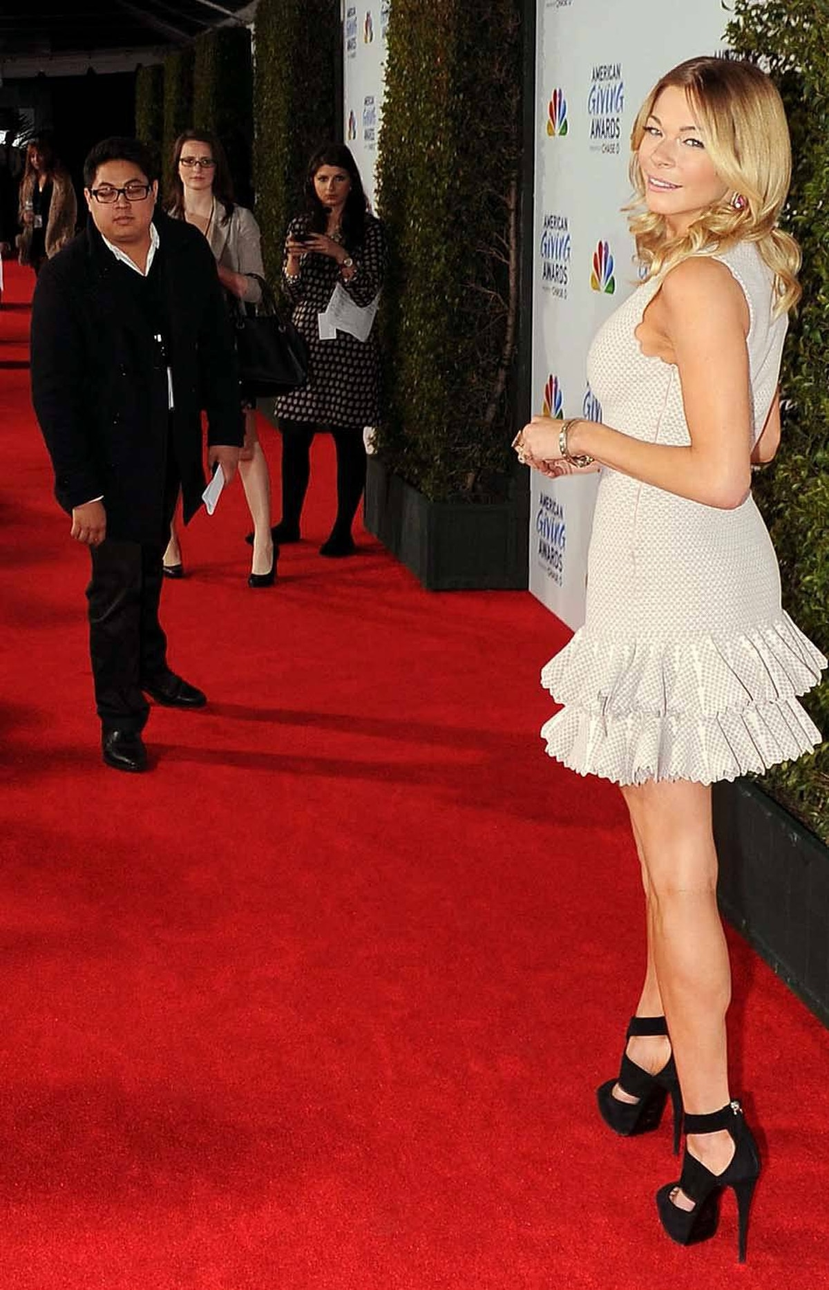 Singer LeAnn Rimes, arriving at the American Giving Awards in Los Angeles on Sunday, ignores the narcoleptic handler trapped on the red carpet.