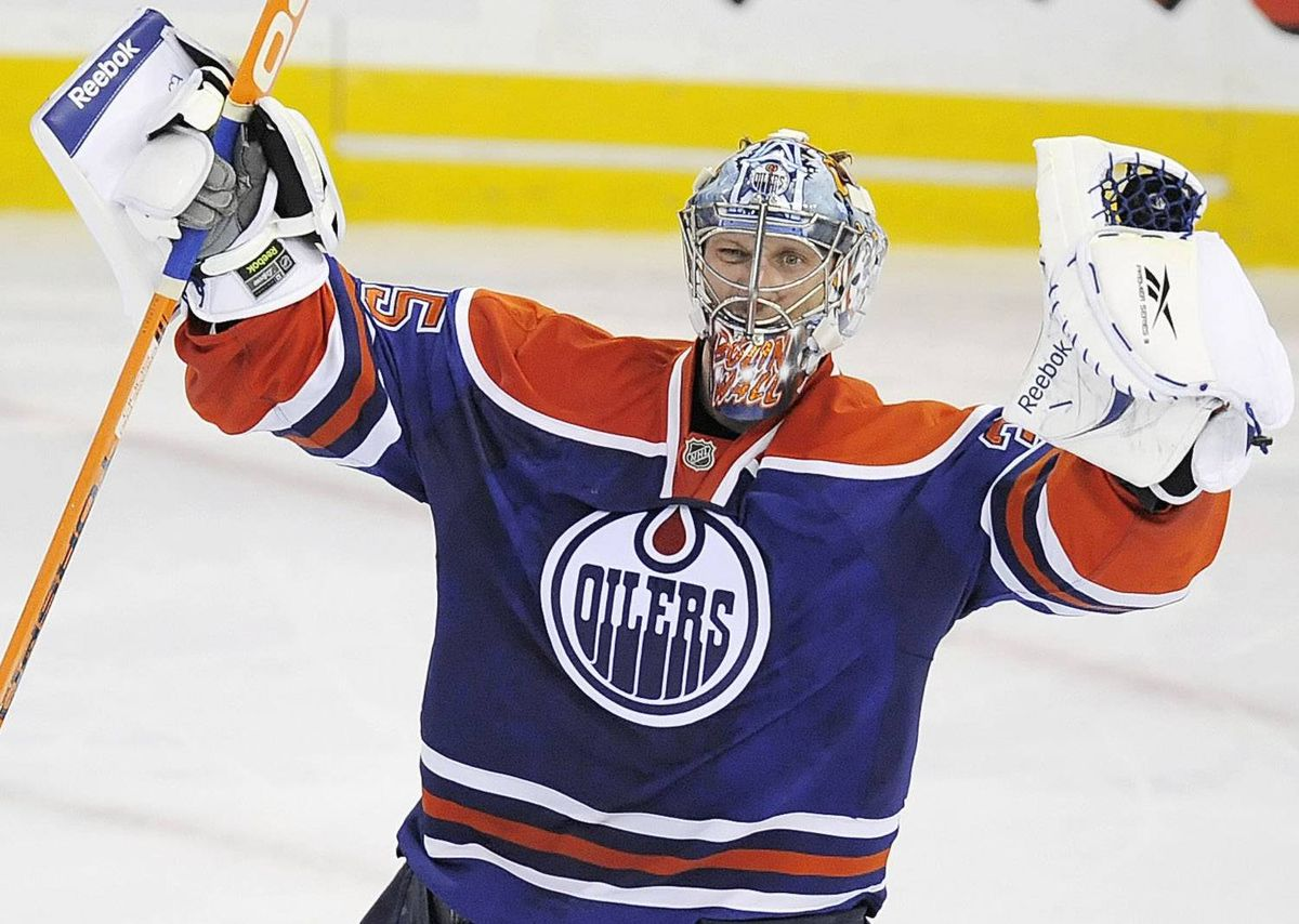 Edmonton Oilers goalie Nikolai Khabibulin (35), from Russia, celebrates his team's win in the overtime shootout of an NHL hockey game in Edmonton, Alberta on Tuesday, October 6, 2009. Edmonton beat Dallas 5-4 after an overtime shootout. THE CANADIAN PRESS/Jimmy Jeong