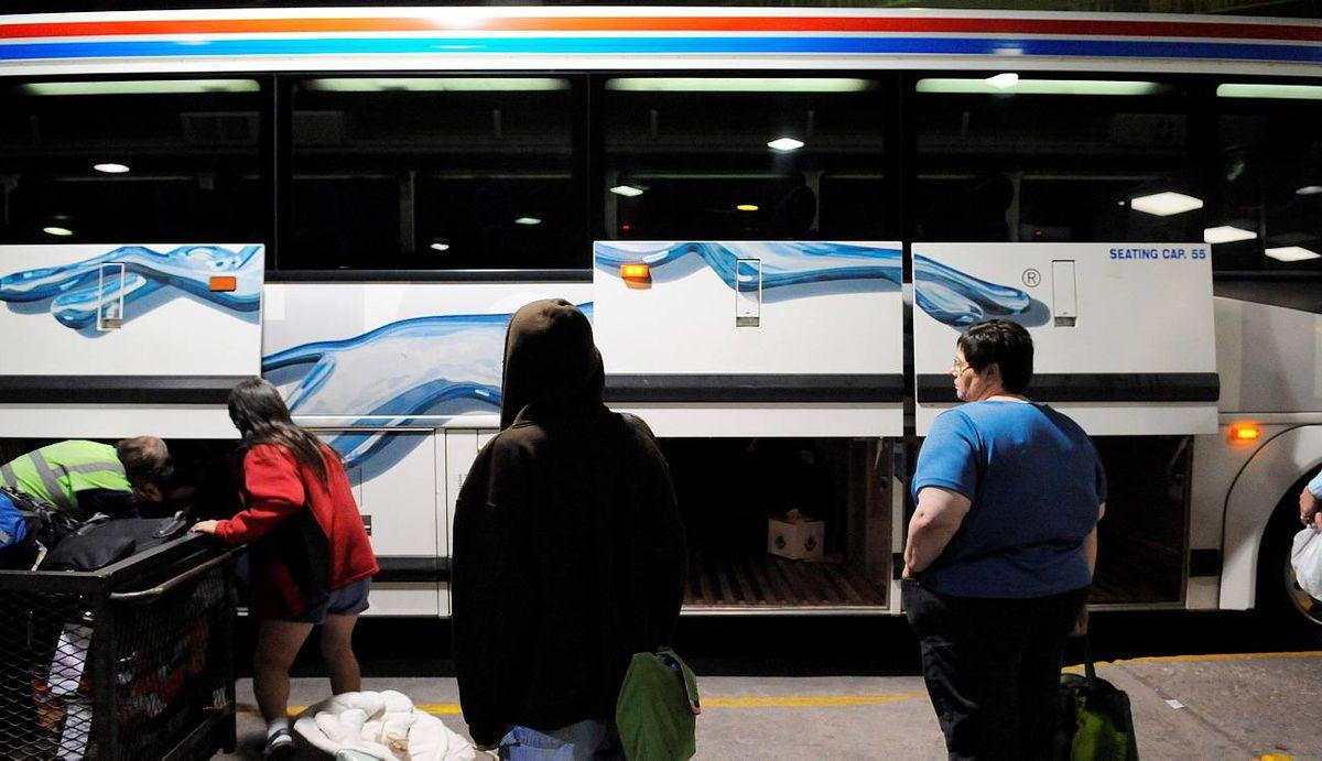 Passengers arrive in Winnipeg on a Greyhound bus.