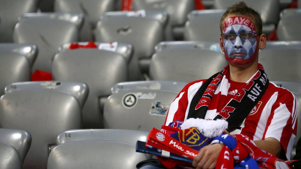 A supporter of Bayern Munich reacts as his team was defeated at penalty shootout by Chelsea during their Champions League final soccer match at the Allianz Arena in Munich May 19, 2012. REUTERS/Kai Pfaffenbach