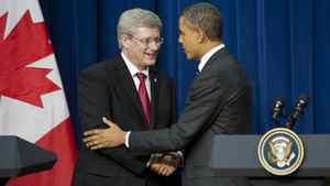 U.S. President Barack Obama and Prime Minister Stephen Harper shake hands at a news conference on Dec. 7, 2011, in Washington, D.C. The two spoke after a meeting to discuss the countries' bilateral relationship.
