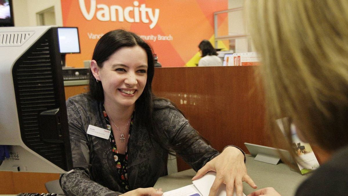 Vancity's Jennifer Potter, Senior Financial Services Representative, helps a client at the company's head office in Vancouver.