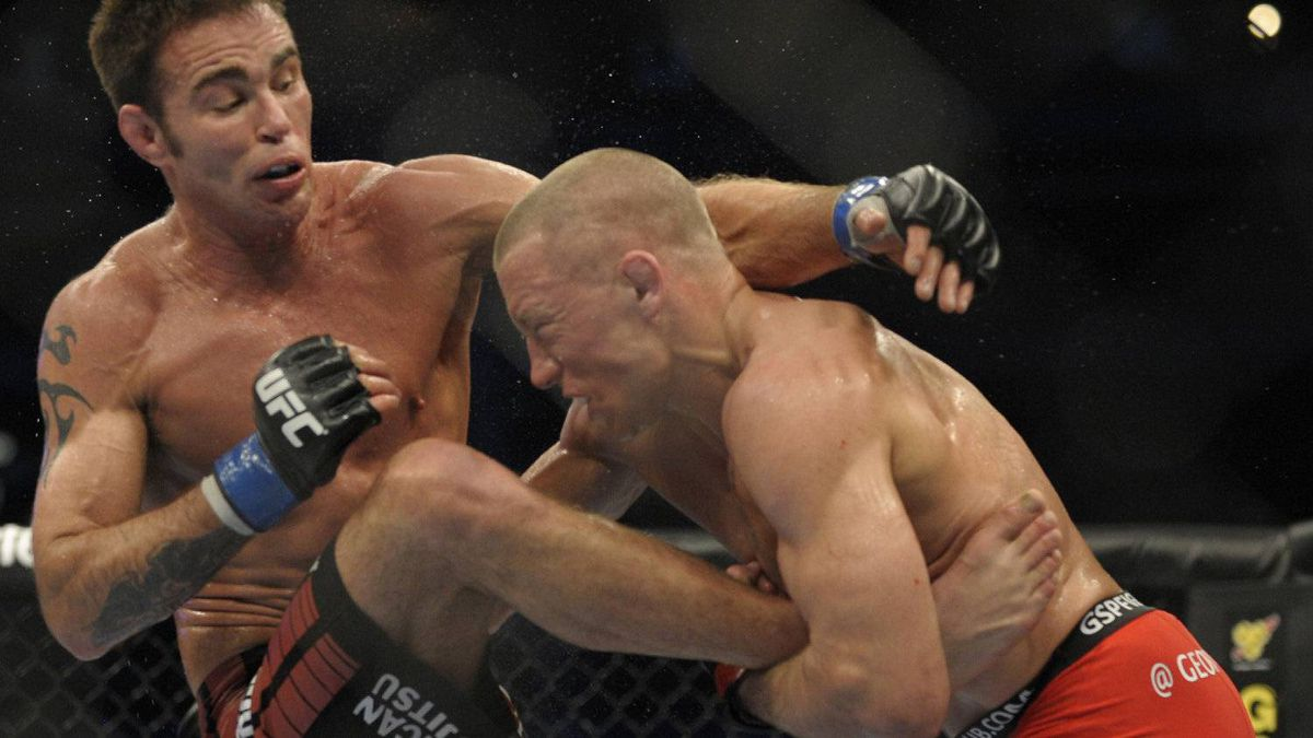 Georges St-Pierre, in the red shorts, fought to a unanimous decision win over Jake Shields in the welterweight title bout at UFC 129 at the Rogers Centre on April 30, 2011.