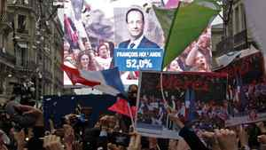 The face of of the newly-elected French President Francois Hollande appears on a giant screen to announce the winner of the 2012 French presidential elections at the Rue de Solferino Socialist Party headquarters in Paris, May 6, 2012. France voted in elections on Sunday and Francois Hollande became the nation's first Socialist president in 17 years, early results said