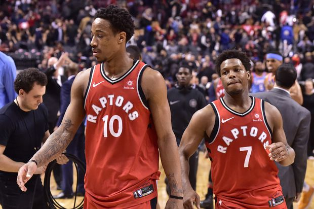 90cc5ccaec6e Toronto Raptors guards DeMar DeRozan and Kyle Lowry walk off the court  after losing to the Los Angeles Clippers on March 25