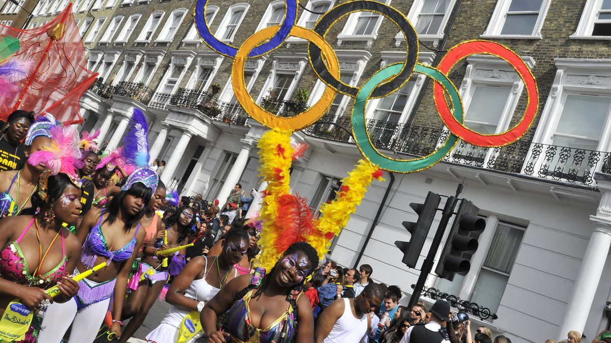 A performer dances with Olympic rings strapped to her back, during the street parade at the annual Notting Hill Carnival in central London August 29, 2011.