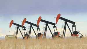 Four pumpjacks on the prairie.