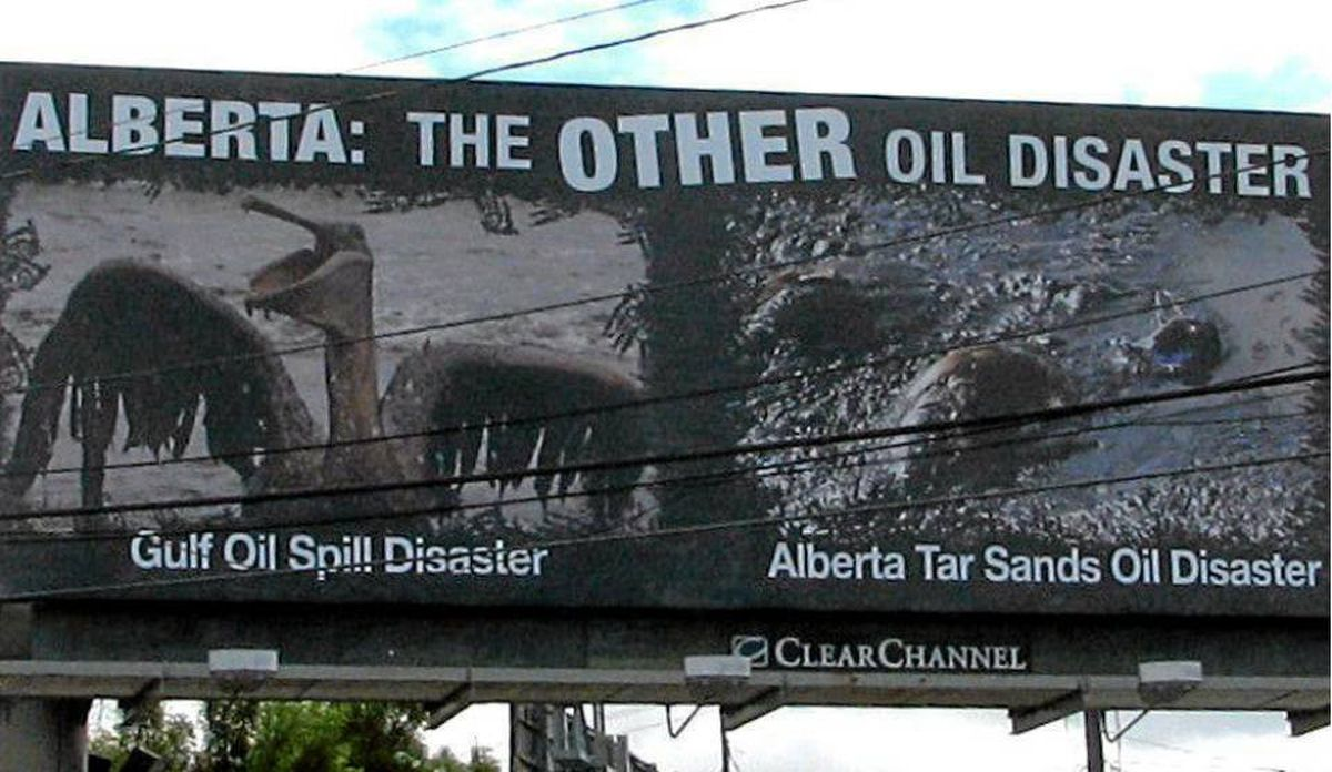 A Seattle billboard urges would-be vistors to Alberta to rethink their plans.