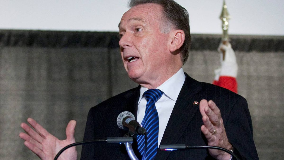 Environment Minister Peter Kent holds a news conference in Ottawa, Monday November 28,2011 as he prepares to leave for climate talks in Durban later this week.