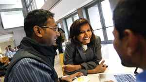 Sonali Dash, centre, an MBA student from India, chats with fellow MBA students Purnendu Nayak, left, and Sri Harsha, also from India while on break at York University's Schulich School of Business in Toronto.