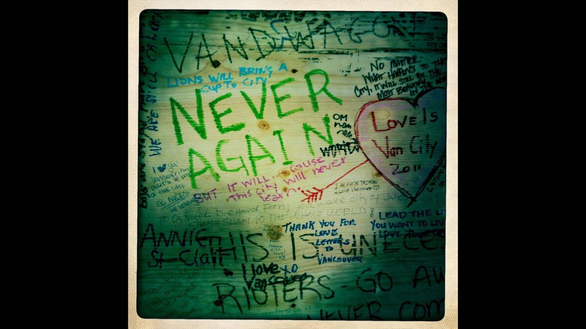 Messages written on plywood covering broken windows of the Hudson's Bay Company after last week's riot in Vancouver, British Columbia, Sunday, June 19, 2011.