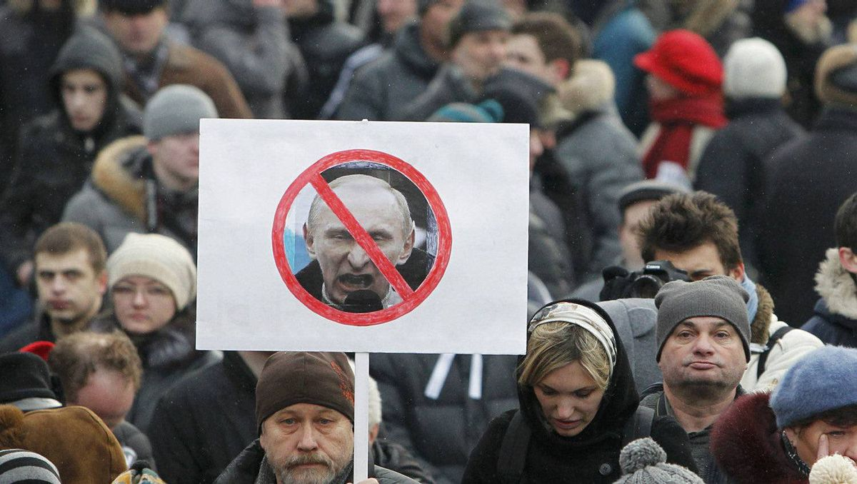 Opposition supporters gather before a protest demanding fair elections in central Moscow March 5, 2012.