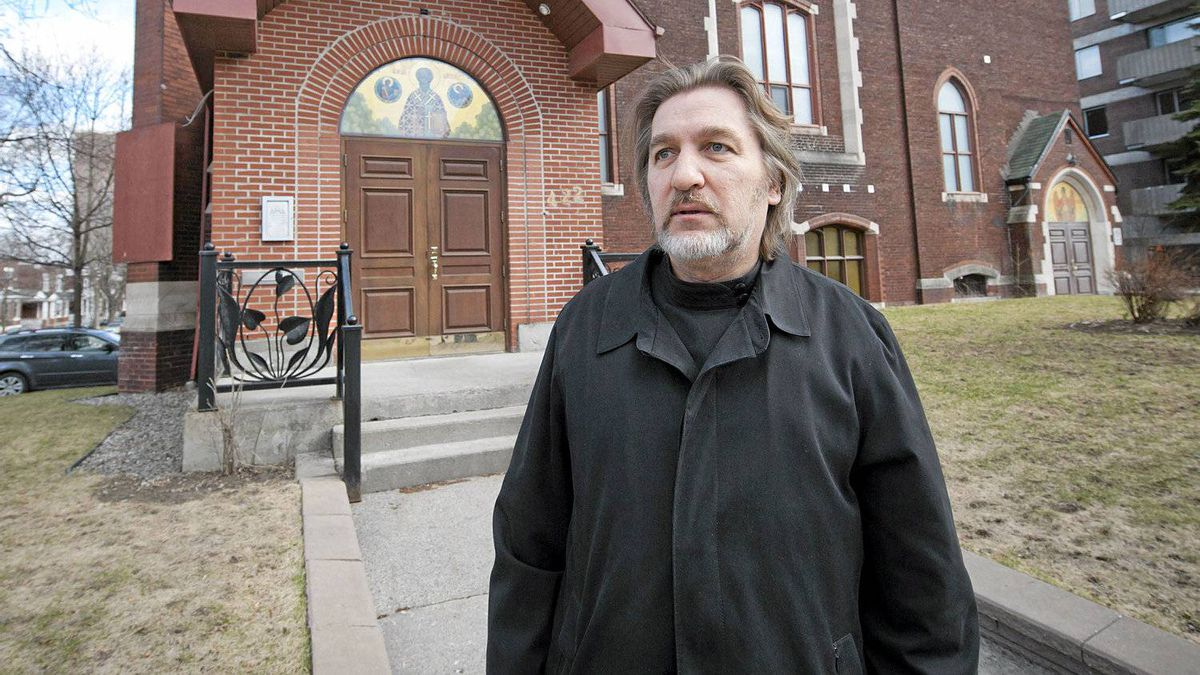 Father George Lagodich stands in front of St Nicholas Russian Cathedral in Outremont, a borough of the city of Montreal, on Thursday, April 5, 2012.