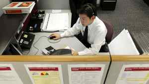 An employee of Vanguard Group Inc. answers calls from investors at the company's headquarters in Malvern, Penn., Feb. 26, 2008.