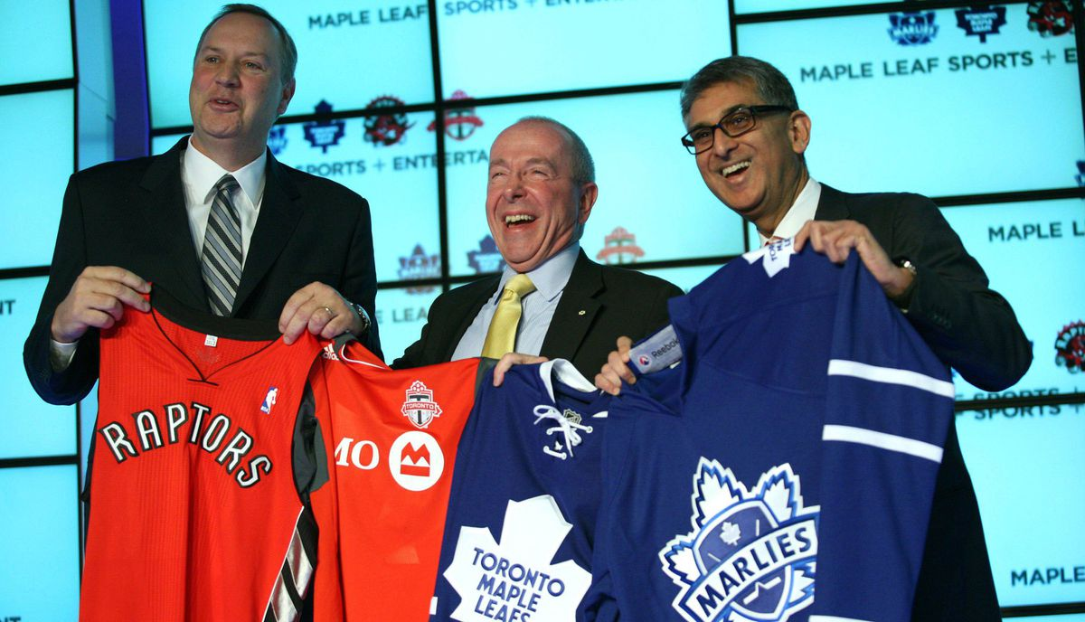 (L-R) George Cope, President and CEO of Bell Canada and BCE, Lawerance M. Tanenbaum, Chairman of Maple Leaf Sports and Entertainment and Nadir Mohamed, President and Chief Executive Officer, Rogers Communication, pose for a photo after announcing a joint ownership arrangement between Rogers and Bell in the purchase of 75% ownership in Maple Leaf Sports and Entertainment.