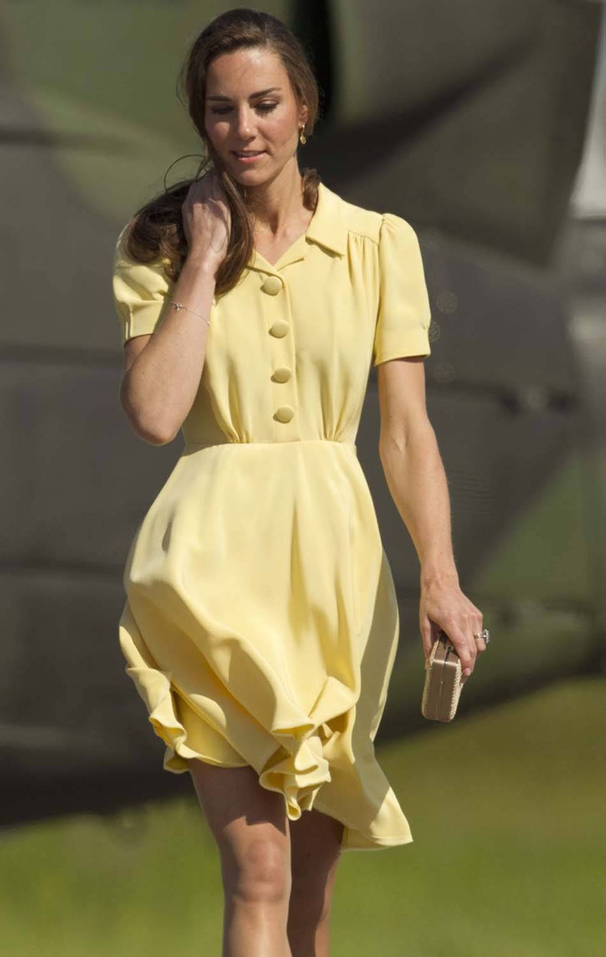 The Duchess touches down in Calgary on July 7 wearing a summery dress by British designer Jenny Packham.
