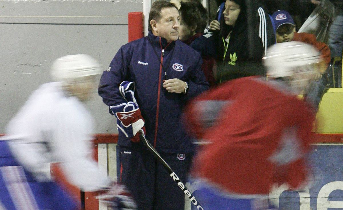 Montreal Canadiens coach Jacques Martin looks on as players skate during a practice in Clermont, 150km East of Quebec City, Wednesday October 6, 2010. Francis Vachon