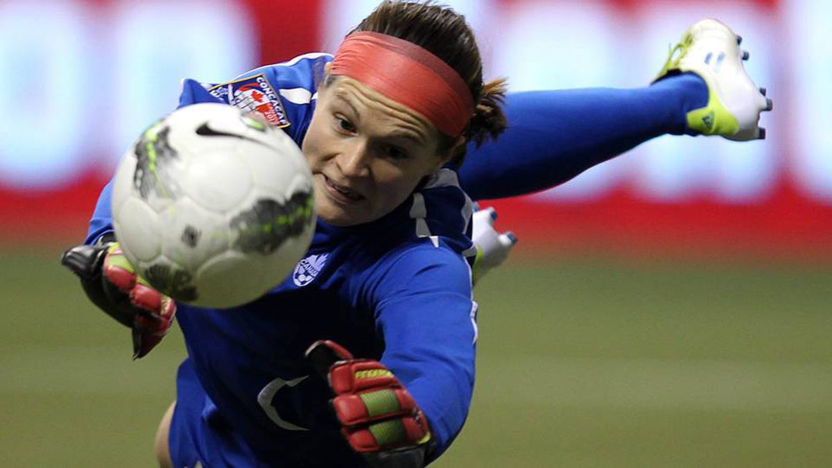 Canada goalkeeper Erin McLeod dives to make a save during the second half of CONCACAF women's Olympic qualifying final soccer action against the United States in Vancouver