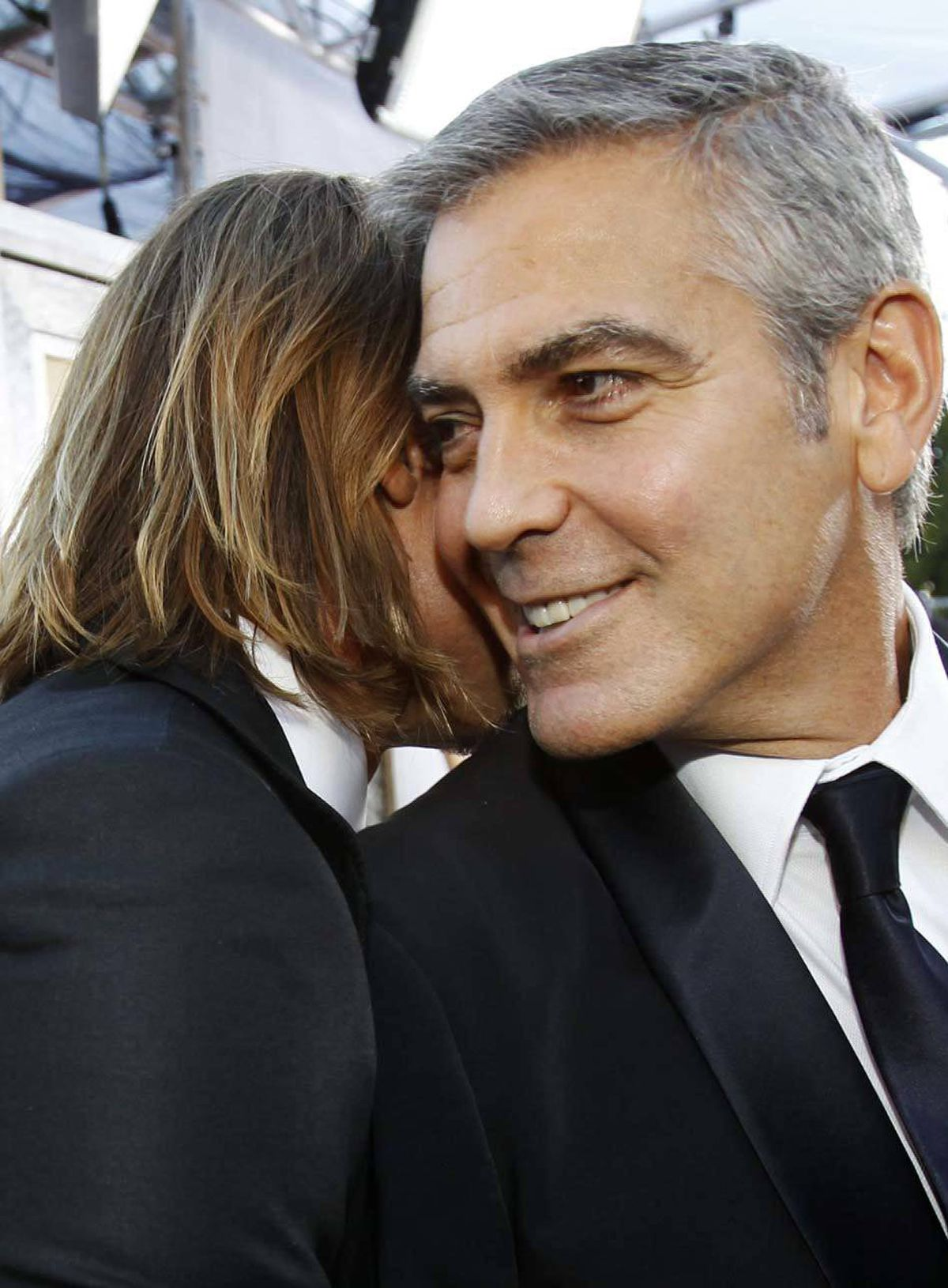 George Clooney and Brad Pitt compare shaves at the SAG awards in Los Angeles on Sunday.