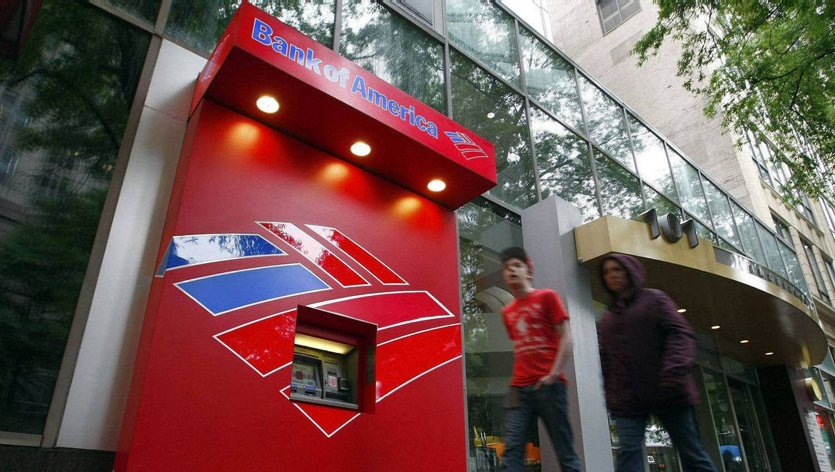 Pedestrians walk past a Bank of America ATM in Charlotte, North Carolina April 18, 2012.
