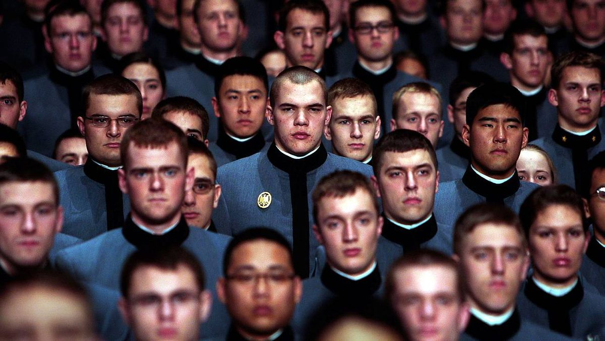 Cadets stand for the national anthem before a speech by U.S. President Barack Obama in Eisenhower Hall at the United States Military Academy at West Point on Dec. 1, 2009.