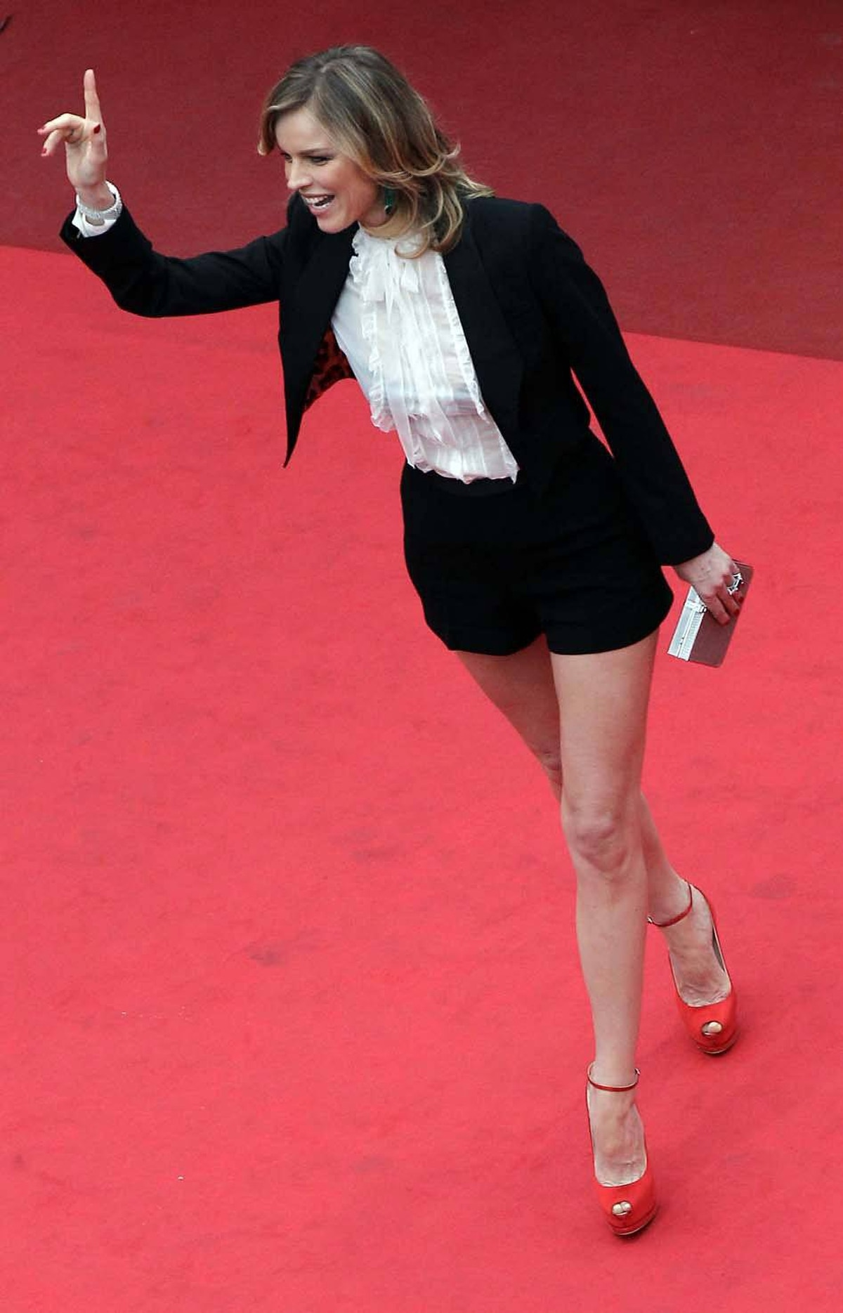 Model Eva Herzigova orders up a coffee on the red carpet at the Cannes Film Festival on Wednesday.