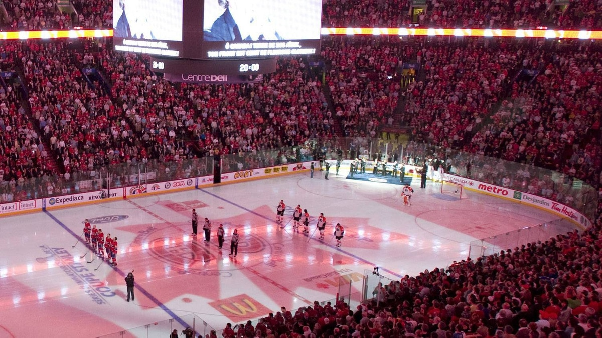 In this file photo Players from the Montreal Canadiens and the Philadelphia Flyers stand for the Canadian national anthem at the Bell Centre in Montreal, Thursday, May 20, 2010, prior to game 3 of their NHL hockey Eastern Conference final series. In the latest developments at the NHL meetings in Florida, several general managers are suggesting the league to the type of hybrid icing now used in the NCAA and USHL. THE CANADIAN PRESS/Graham Hughes