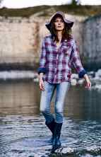 SILVER Family-owned Silver Jeans Inc. is celebrating its 25th anniversary this year. The label specializes in casual denim and shirting that blends modern and vintage details in trend-focused washes at walletfriendly prices. (Silver Pioneer bootcut jeans, $105, plaid shirt, $69; Gap hat, $14.99)
